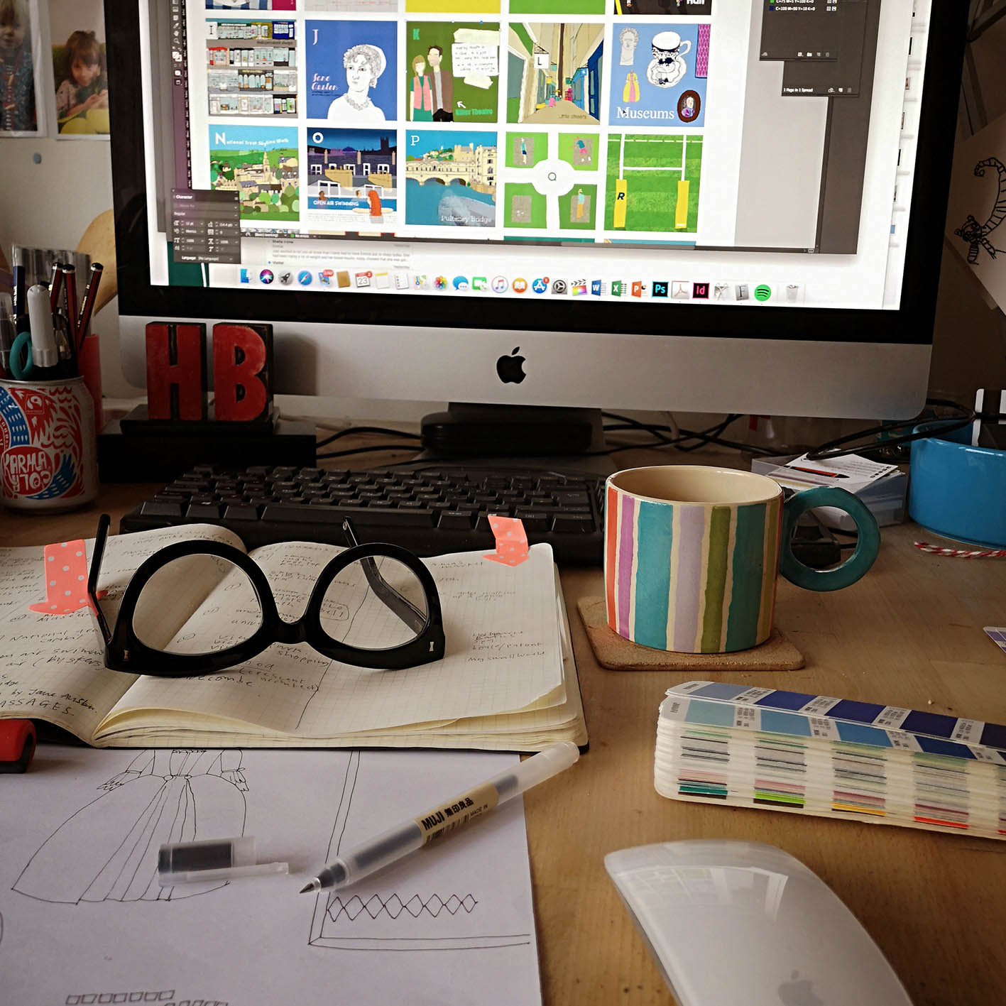 Just one of Hannah's mugs, alongside her specs and a sneaky peek at a new print in progress...