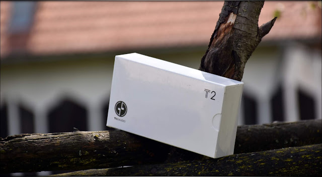 Tin T2 White Package, seated on a wooden construction