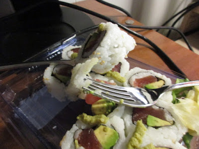Eating sushi roll with a fork vs. a spoon tuna avocado