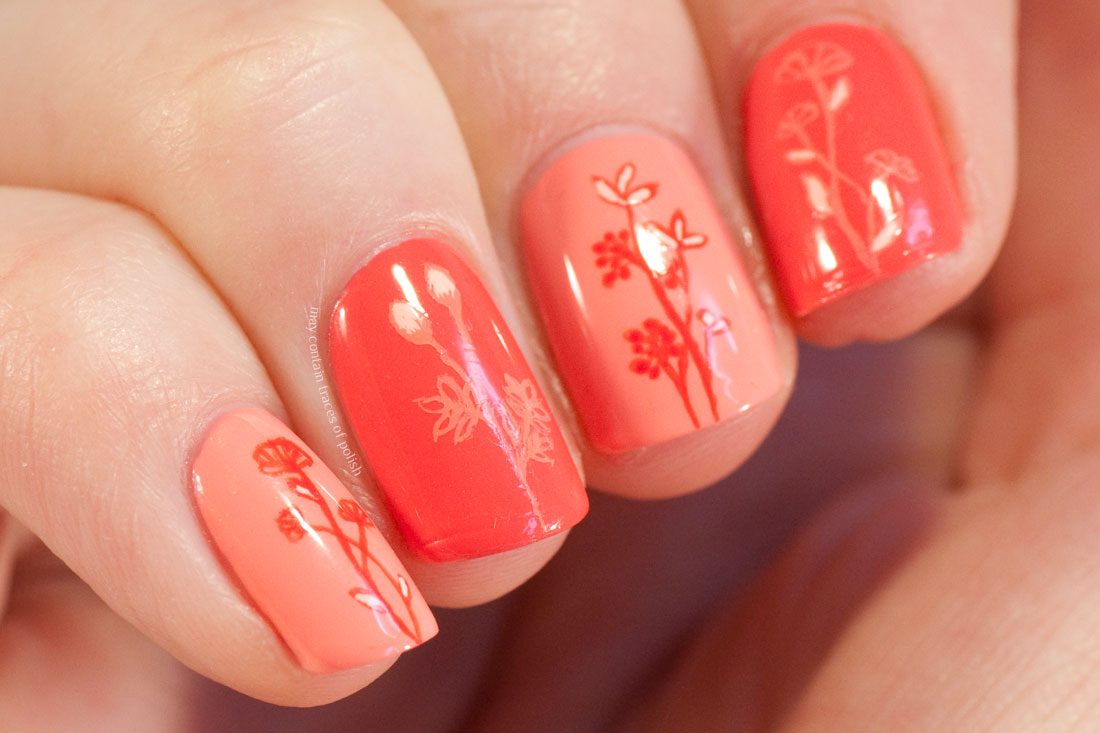 Minimalist Floral Nail Art in coral pink tones