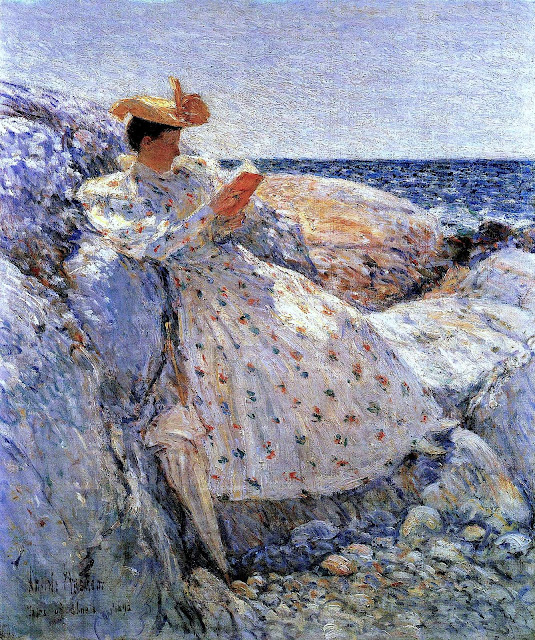 A Childe Hassam painting of a woman reading by rocks and shore