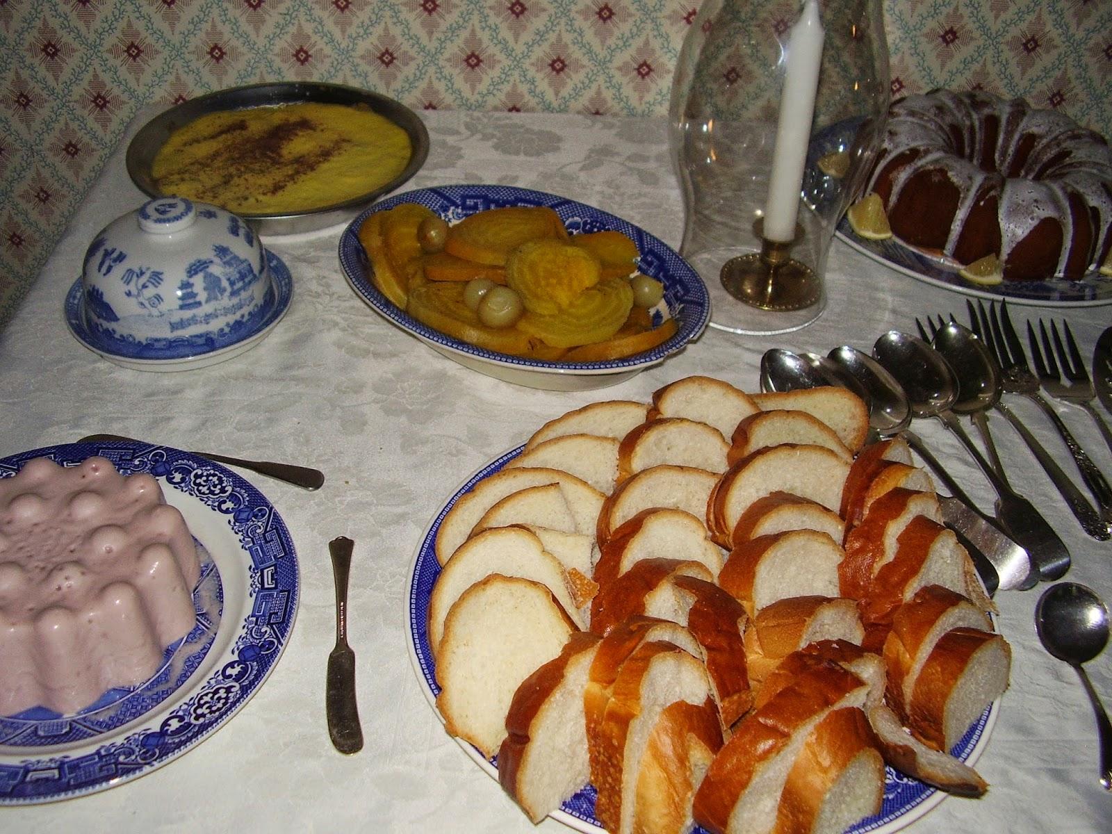 Side board with dishes: raspberry cream, apple custard, lemon cake.