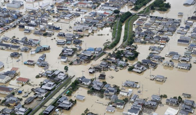 Japan flood kills 12 as rescuers search for survivors