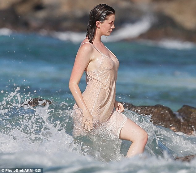 Ireland Baldwin poses for sexy shoot wearing nothing but a negligee in the ocean