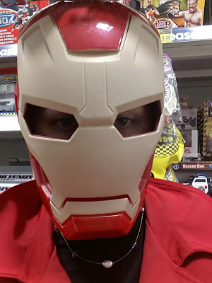An adult in an Iron Man mask.