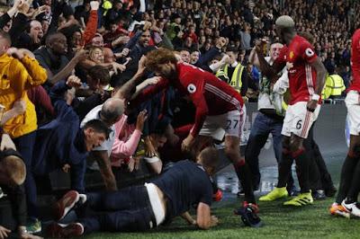 Marouane Fellaini was quick to help the fan