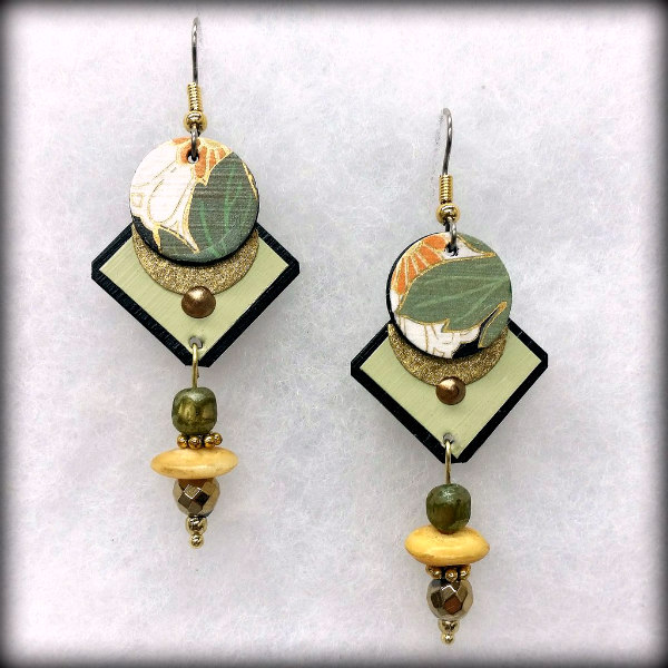 geometric paper and glass bead dangle earrings in shades of green, yellow and black in gift box