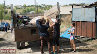 http://en.censor.net.ua/photo_news/403623/roma_family_evacuates_belongings_from_loshchynivka_following_bashing_after_8yearolds_murder_photos