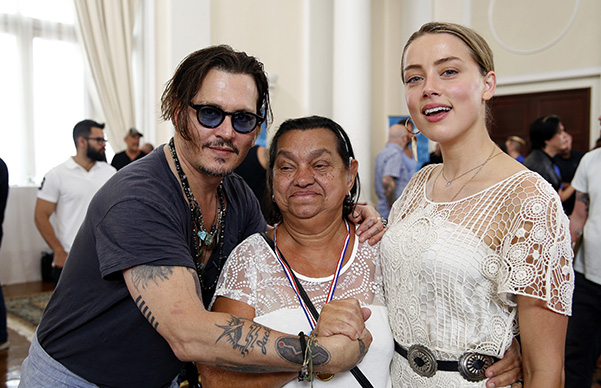 Amber heard and johnny Depp a charity event for people with hearing