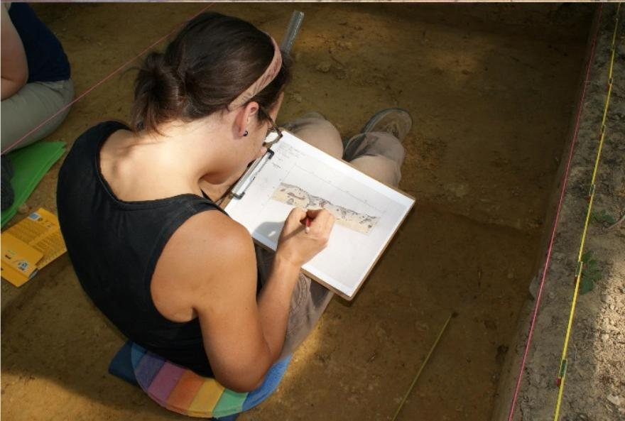 Archaeologist Rachel Kulick drawing unit wall