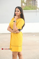 Actress Poojitha Stills in Yellow Short Dress at Darshakudu Movie Teaser Launch .COM 0063.JPG