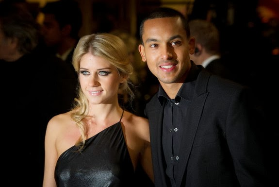 Theo Walcott and Melanie Slade's baby could well arrive at the time of the 2014 World Cup