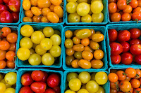 Tomatoes at a farmers' market in Wisconsin. (Credit: Patrick Kuhl/Flickr) Click to Enlarge.