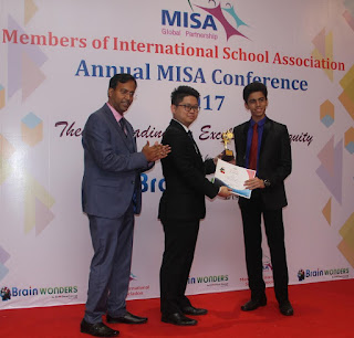 Mr. Manish Naidu, Founder, Brainwonders and Mr. Henry LEE Yan Fong, WellGene International Business Partner felicitating the student Jash