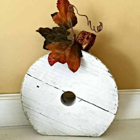 pumpkin with a stem and a leaf