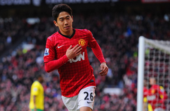 Manchester United player Shinji Kagawa celebrates after completing his hat-trick against Norwich