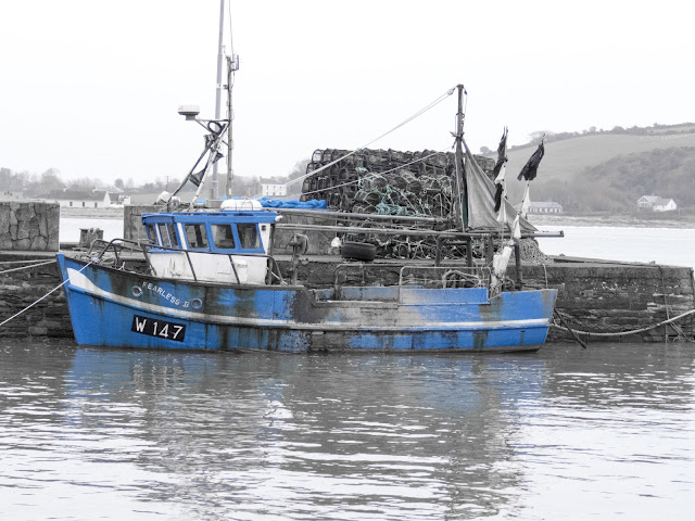 Blue fishing boat in Youghal, County Cork spotted on a road trip in Ireland between Dublin and Kinsale