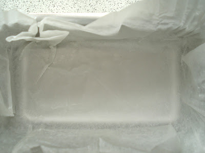 Line a small tin with baking parchment
