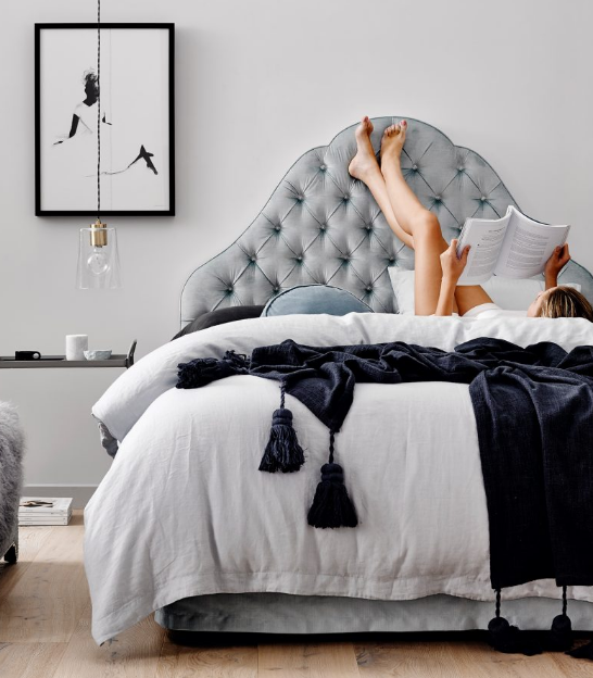 The deep indigo walls allow stunning bed heads and chandeliers pop