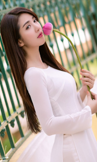Hot Girl Linh Napie in white Aodai dress with pink lotus