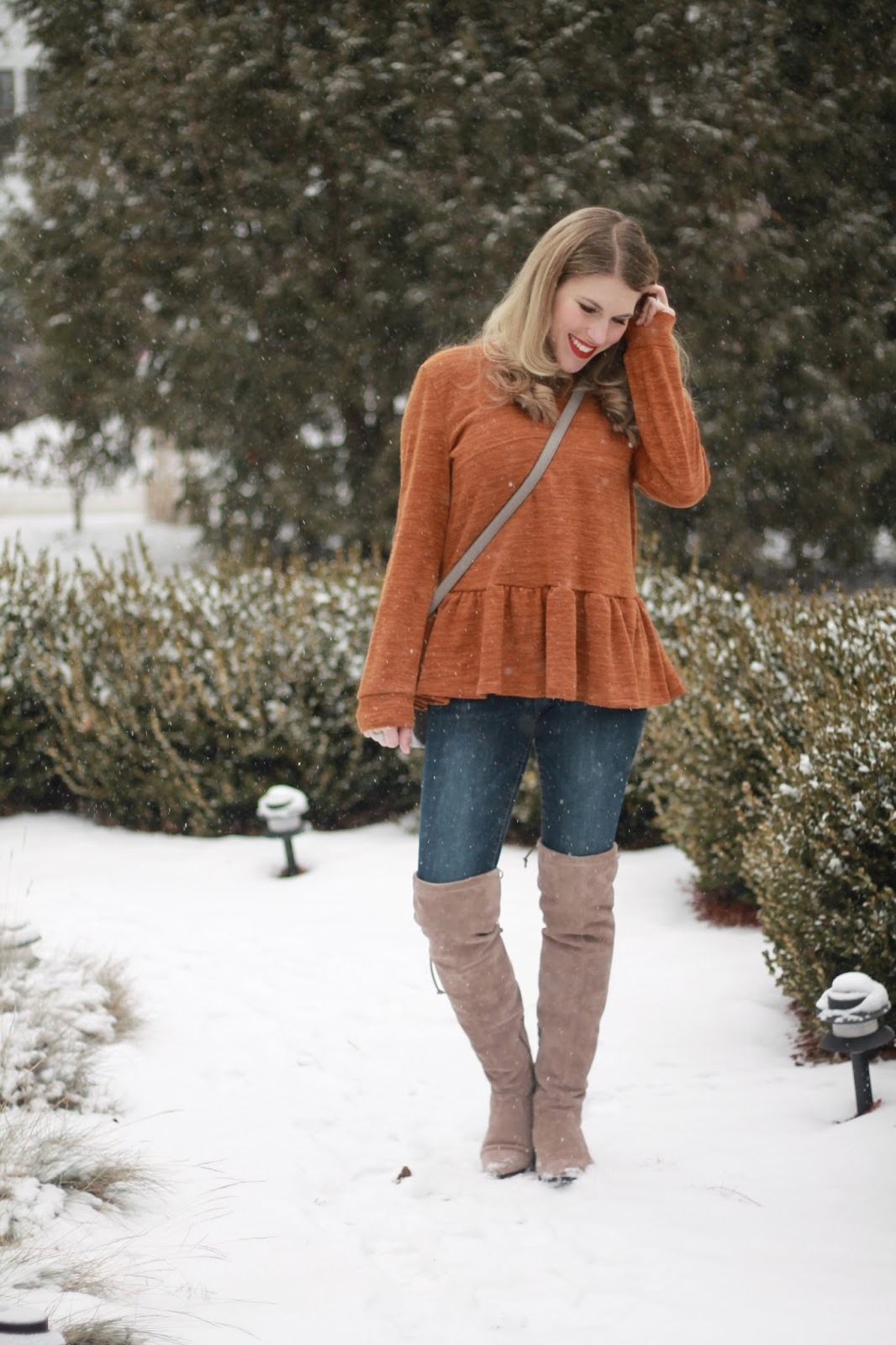 burnt orange peplum sweater, rockstar jeans, grey saddlebag, taupe otk boots