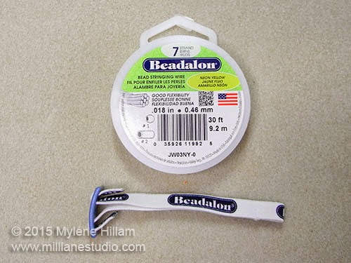 Beadalon Spool Tamer and a spool of beading wire.
