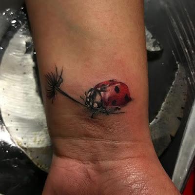 wrist ladybug tattoo