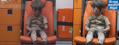 5-year-old Omran Daqneesh, with bloodied face, sits with his sister