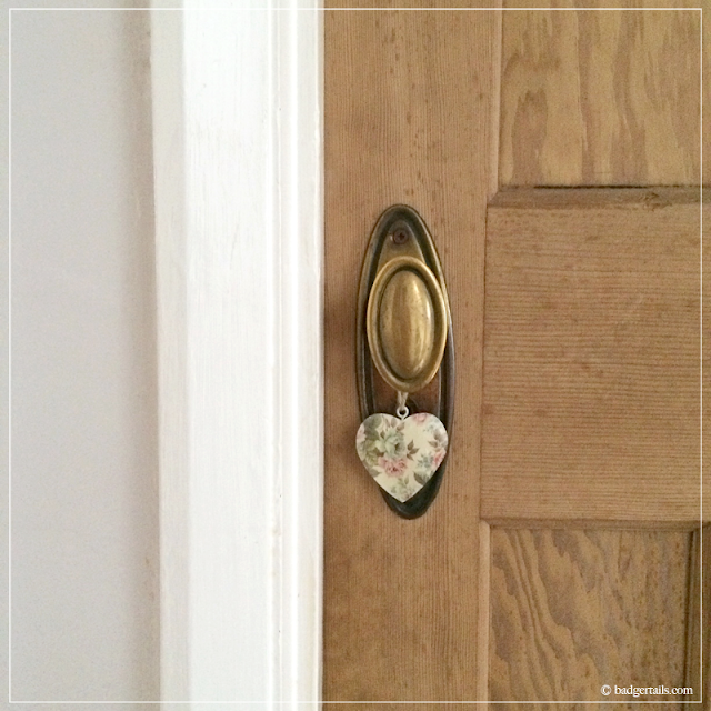 Floral-Metal-Heart-Hanging-on-Old-Door-Handle