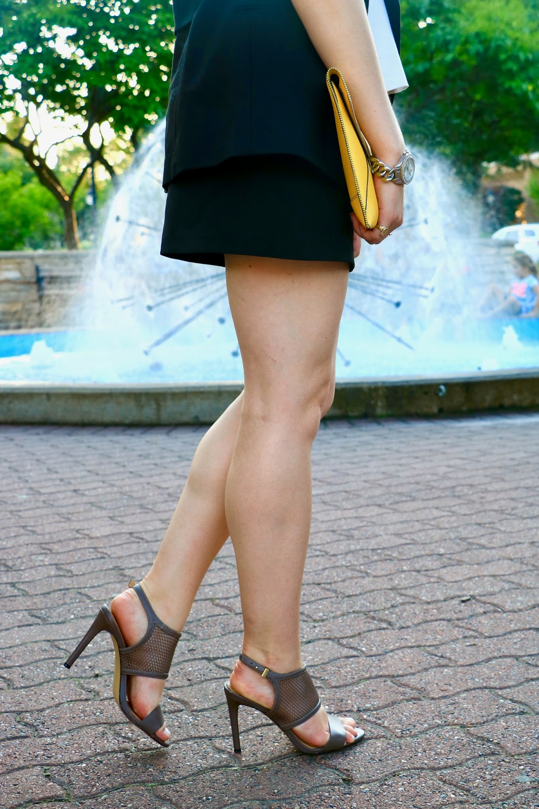 NYC fashion blogger Kathleen Harper of Kat's Fashion Fix wearing shorts with heels