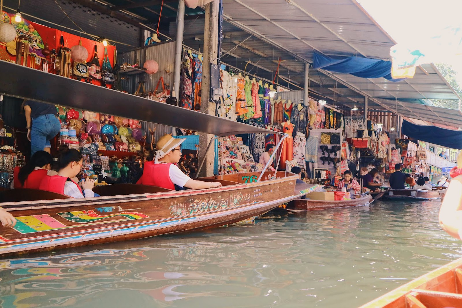 tourists in Damnoen Saduak Floating Market