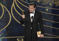 Leonardo DiCaprio holds Oscar (Photo Credit: Chris Pizzello/Invision/AP) Click to Enlarge.