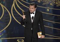 Leonardo DiCaprio holds Oscar (Photo Credit: Chris Pizzello/Invision/AP) Click to Enlarge.