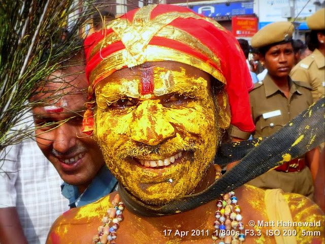 street portrait, Dravidian people, South India, Madurai, Chithirai festival, headshot, Hindu man, yellow painted face, Vishnu sign, Facing the World, © Matt Hahnewald