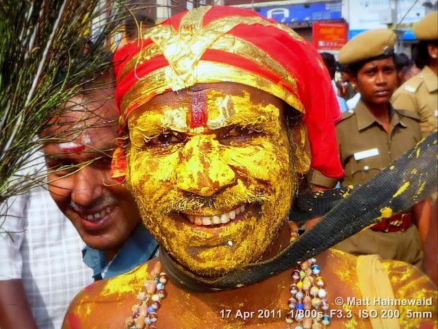 street portrait, Dravidian people, South India, Madurai, Chithirai festival, headshot, Hindu man, yellow painted face, Vishnu sign, Facing the World, © Matt Hahnewald