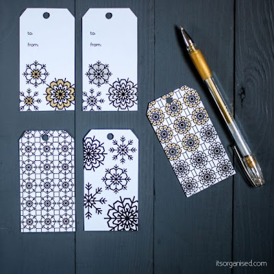 http://itsorganised.com/printable-colouring-in-snowflake-labels/