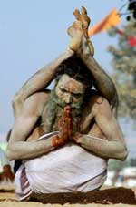Photo of a yogi with his legs up behind his shoulders