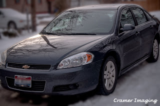 Photograph of a sedan style grey car parked on snow in Pocatello, Bannock, Idaho by Cramer Imaging