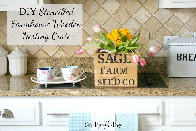 stencilled wood crate flowers tea cups