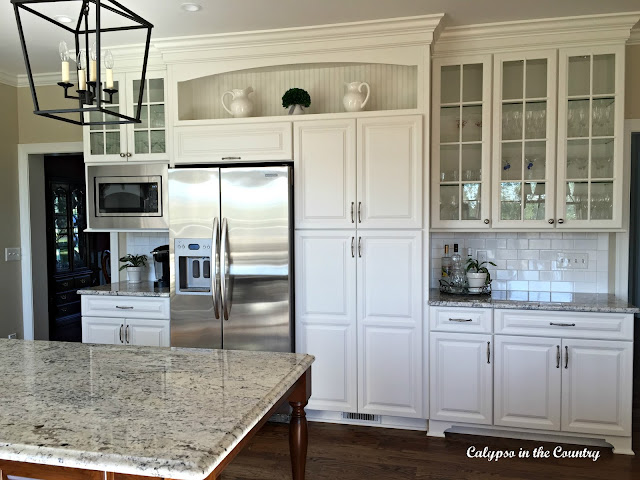White Cabinets with Shelf and bar area