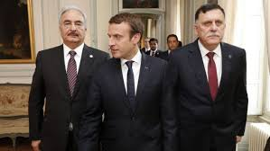 """Libyan National Army's chief Khalifa Hafta (left) and UN-backed Prime Minister Fayez al-Sarraj (right) met in Paris with French President Emmanuel Macron  Libya's opposing governments have committed to a conditional ceasefire following talks in France.  UN-backed Prime Minister Fayez al-Sarraj and Khalifa Haftar, the rival military commander who controls the east, met in Paris on Tuesday.  They are aiming to end the conflict which has engulfed the country since Col Muammar Gaddafi was ousted in 2011.  French President Emmanuel Macron said the rivals could soon be seen as symbols of Libya's reconciliation.  """"We commit to a ceasefire and to refrain from any use of armed force for any purpose that does not strictly constitute counter-terrorism,"""" they said in a joint, 10-point statement.  The document also pledged to move towards holding elections – which could take place as early as 2018 – and """"building the rule of law"""" in a country struggling to control the armed groups which have stepped into the power vacuum left by the Gaddafi regime.  Why is Libya so lawless? Libya country profile Mr Sarraj's Government of National Accord (GNA), which is backed by the UN and based in the capital Tripoli, has tried to win the support of the various militias and politicians since coming to power in 2016.  But Gen Haftar's self-styled Libyan National Army (LNA), based in Tobruk, 1,000km (620 miles) to the east, refuses to recognise the GNA. Gen Haftar is leading the battle against Islamist militants, and recently declared victory in Benghazi, the country's second city.  Image copyright AFP  Image caption  French President Emmanuel Macron (far right) also met with Mr Sarraj (far left) on Tuesday  Talks earlier this year failed to result in a joint statement. However, the two men shook each others' hands following this latest round, which was chaired by the UN's envoy to Libya, Ghassan Salame.  """"The cause of peace has made a lot of progress today,"""" Mr Macron told reporters gathered at """