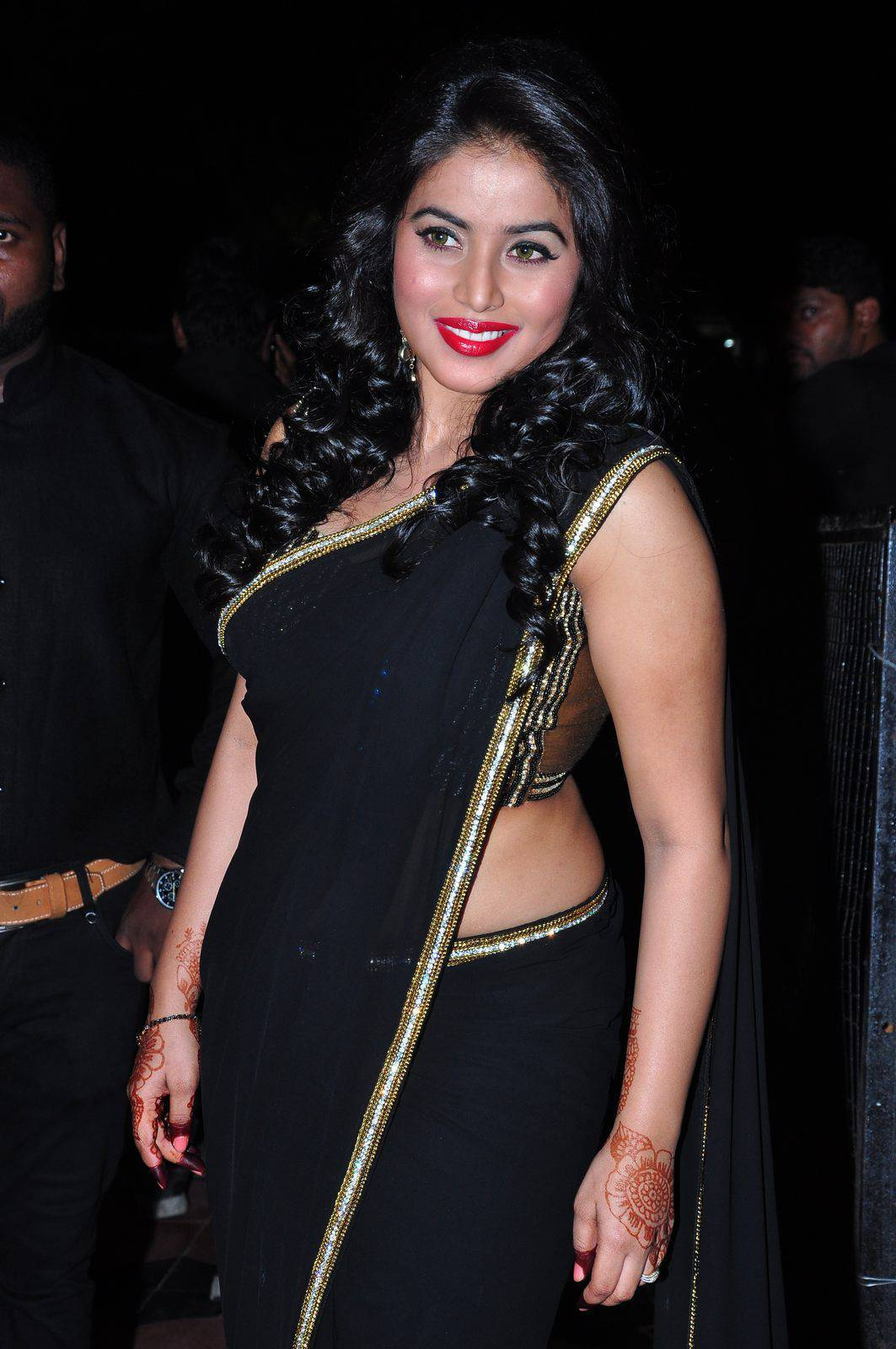 Tollywood Actress Poorna Hip Navel In Black Saree
