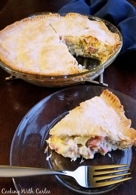 pot pie with first slice on plate and ready to eat