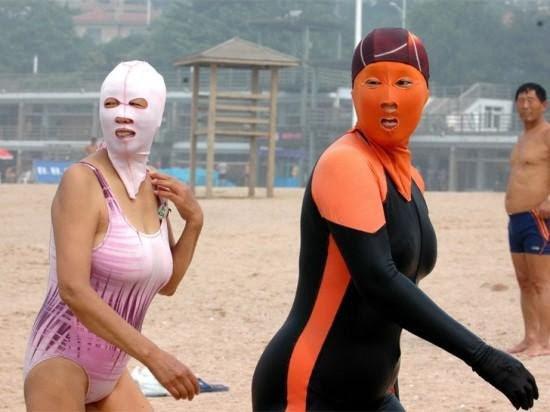 Chinese women wearing bikini masks on a beach