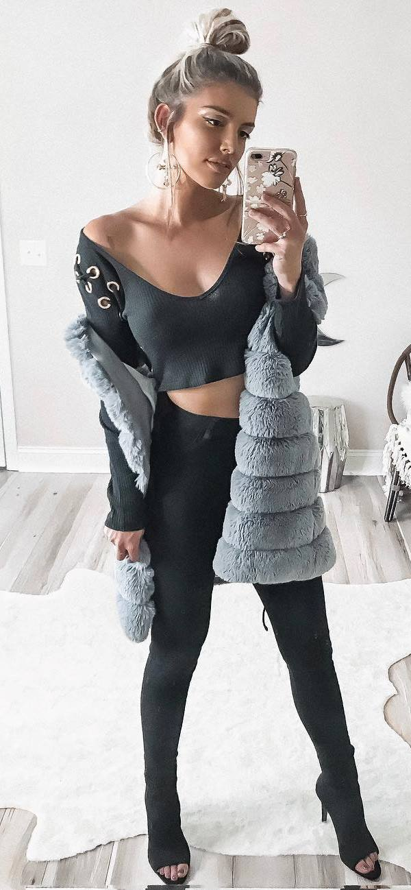 fall trends / lace up sweater + fur vest + black skinnies + boots