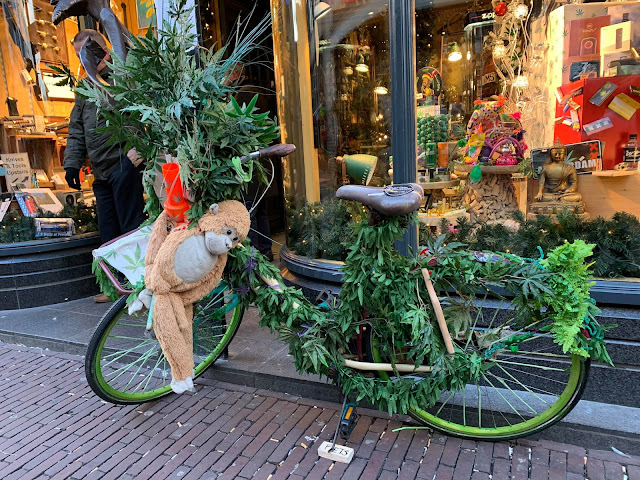 bicycle outside a shop covered in cannabis leaves