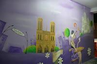 Aranżacja ściany poprzez malowanie obrazu na ścianie w Warszawie, mural ścienny