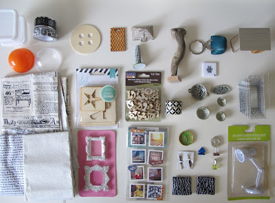 Selection of dolls' house miniatures and craft items laid out on a tabletop