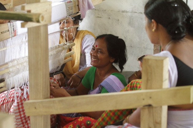 Mishing tribal women and their traditional looms, Assam