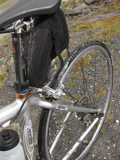 Snow on rear brakes and wheel, Gemmipass, Switzerland